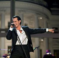 Latin artist Marc Anthony's self-titled English-language album released in 1999 had singles that crossed over to the AC charts.