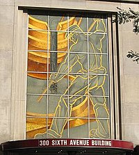 Downtown facade memorializing Pittsburgh's industrial heritage with an image of legendary steelworker Joe Magarac