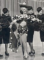 Carmen Miranda as Dorita in The Gang's All Here. In 1946, she was the highest-paid actress in the United States.