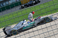 Schumacher climbs out of his car after spinning off during the final practice session at the . He retired from the race with gearbox problems.