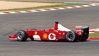 Schumacher driving the Scuderia Ferrari Marlboro F2002 at the 2002 French Grand Prix, the race at which he clinched the Drivers' Championship, setting the record for the fewest races in locking up the title