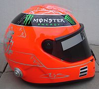 """Schuberth helmet for the 2011 season (Mercedes GP); Schumacher kept using a red-coloured helmet at Silver Arrows. Chinese dragon illustration and a Chinese character """"力"""" (""""power"""") are inscribed on the back of the helmet."""