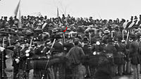 Gettysburg, November 19, 1863. Crowd of citizens, soldiers, etc., with a red arrow indicating Abraham Lincoln