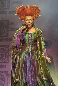 Midler (in costume as her character Winnifred Sanderson from Hocus Pocus) performing on her Divine Intervention Tour in 2015
