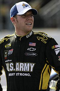 Regan Smith (pictured in 2007) who was demoted from second to eighteenth for passing Stewart below the yellow line.
