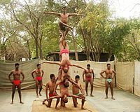 A mallakhamba team of the Indian Army's Bombay Sappers performs on the pole.