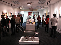 """The main gallery at the GLBT Historical Society headquarters at 657 Mission St., San Francisco; opening of the """"Polk Street: Lives in Transition"""" exhibition, curated by Joey Plaster (Jan. 16, 2009)."""