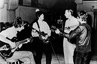 Music producer Sir George Martin, best known for his work with The Beatles, pictured with members George Harrison, Paul McCartney and John Lennon at a recording session at Abbey Road in 1966