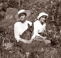 Grand Duchesses Tatiana and Anastasia and the dog Ortipo in captivity at Tsarskoe Selo in the spring of 1917