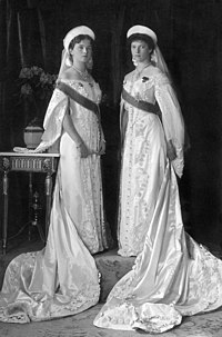 Grand Duchesses Olga and Tatiana in court dress in a formal portrait taken in 1913