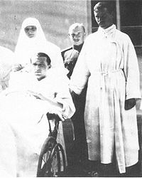 Grand Duchess Tatiana Nikolaevna wearing a Red Cross nursing uniform and Dmitri Yakovlevich Malama