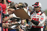 Biffle signs autographs along pit lane at Pocono Raceway