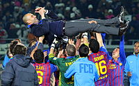 Pep Guardiola is hoisted in the air after Barcelona won the 2011 FIFA Club World Cup, crushing Santos 4–0 in the final.