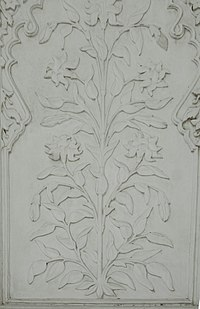 Floral designs on marble, as seen on the tomb's interior walls