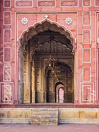 Entrance to the main prayer hall is through arches made of red sandstone city was made an imperial capital by the earlier Emperor, Akbar, who established the nearby Lahore Fort.