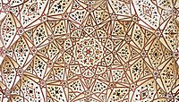 The ceiling of the prayer hall is embellished with elegant floral frescoes and Middle-Eastern style muqarnas.