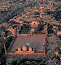 Badshahi Mosque stands across the Hazuri Bagh from Lahore Fort.