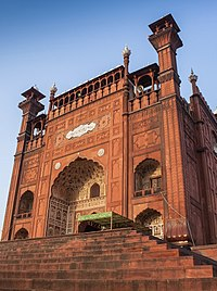 The Badshahi Mosque features a monumental gateway that faces the Hazuri Bagh quadrangle and Lahore Fort.