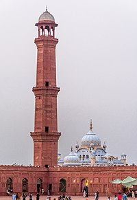 The Samadhi of Ranjit Singh (white edifice) is a Sikh shrine that was built next to the mosque in 1848.