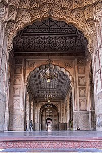The mosque's interior is embellished with Mughal frescoes and carved marble.