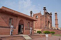 The Tomb of Allama Iqbal is located immediately north of the mosque's monumental gateway