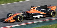 Stoffel Vandoorne in the MCL32, showing the new orange and black livery.