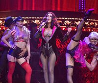 """Cher performing """"Welcome to Burlesque"""" during her Dressed to Kill Tour in 2014"""