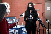 Cher speaking with the media at an early voting center at Fowler Elementary School District in October 2020