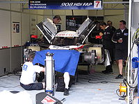 Villeneuve was partnered with fellow ex-Formula One driver Marc Gené, joining them was Frenchman Nicolas Minassian. Here, the trio's number seven Peugeot 908 HDi FAP is being prepared for the Le Mans race.