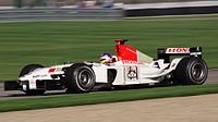 Villeneuve driving for BAR at the 2003 United States Grand Prix. Villeneuve retired from the race ten laps from the finish with an engine problem.