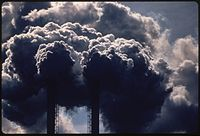Stacks emitting smoke from burning discarded automobile batteries, photo taken in Houston in 1972 by, official photographer of recently founded EPA