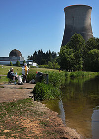 Fishermen near the now-dismantled Trojan Nuclear Power Plant in Oregon. The reactor dome is visible on the left, and the cooling tower on the right.