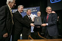 George W. Bush signing the Energy Policy Act of 2005, which was designed to promote US nuclear reactor construction, through incentives and subsidies, including cost-overrun support up to a total of $2 billion for six new nuclear plants.