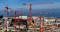 """EDF has said its third-generation EPR Flamanville 3 project (seen here in 2010) will be delayed until 2018, due to """"both structural and economic reasons,"""" and the project's total cost has climbed to EUR 11 billion in 2012. Similarly, the cost of the EPR being built at Olkiluoto, Finland has escalated dramatically, and the project is well behind schedule. The initial low cost forecasts for these megaprojects exhibited """"optimism bias""""."""