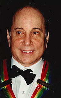 Simon wearing the Kennedy Center Honors ribbon in 2002