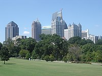 The skyline of Midtown (viewed from Piedmont Park) emerged with the construction of modernist Colony Square in 1972.