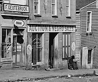 George N. Barnard photograph of Slave trader's business on Whitehall Street Atlanta, Georgia, 1864 ironically shows a United States Colored Troop Infantryman [Corporal] just by the door