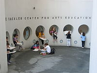 Students sketching at the entrance to the Sackler Center