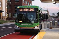IndyGo Rapid bus approaching a Red Line station