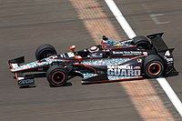 """An Indy car crosses the """"Yard of Bricks"""" practicing for the 2012 Indianapolis 500."""