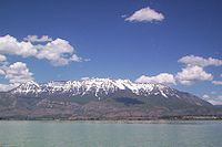 Mount Timpanogos, in the Wasatch Range, viewed from Utah Lake. Several Wasatch Front cities lie between these natural features.