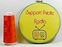 A homemade artwork references the importance of public funding for National Public Radio