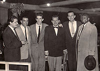 """From left: Chris Gage, Louie Bellson, Stan """"Cuddles"""" Johnson, Tony Gage, Fraser MacPherson, Harry Carney (Photo from the Fraser MacPherson estate)"""