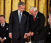 Palmer gives President Bush golf tips before being awarded the Presidential Medal of Freedom, 2004
