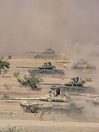 Indian T-90 Bhishma tanks during a training exercise in the Thar Desert, Rajasthan. Note the two different turret armour arrays.