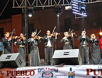 Mariachi group playing.