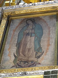 Our Lady of Guadalupe, patron saint of Mexico. This painting of her at the Basilica of Guadalupe is among her most notable depictions; scientists still debate if it should be dated 1531, the year of the first apparition, or the 1550s.