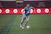 Minnesota United FC player with Target's logo on the jersey nd on the stadium's advertisement boards