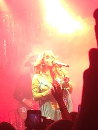 Kesha performing on tour with the Creepies in August 2016
