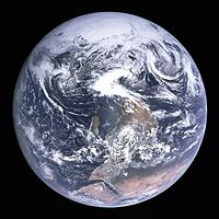 A photo of Earth from Apollo 17 (Blue Marble) with the south pole at the top and the continent of Africa.